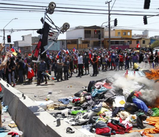 Marcha en Chile, pertenencias venezolanos desalojados